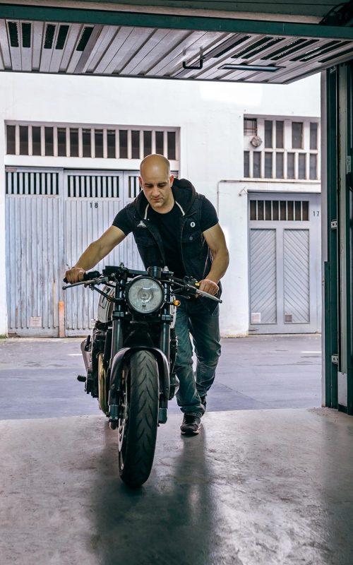 biker-taking-motorbike-to-the-garage-Z57S6QL-resize.jpg